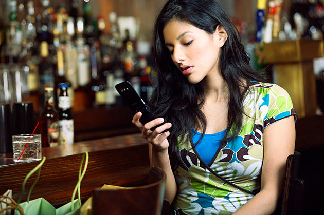 Woman Looking at Text Message on Cell Phone